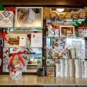 Photo of misc. boxed Chocolates & Gift Tins on wall display unit