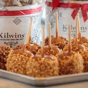 Photo of Peanut & Turtle Caramel Apples with Gift Tins in background