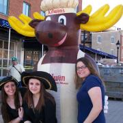 A picture of the Kilwins Moose and friends outside of the store