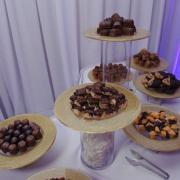 Photos of Kilwins products on platters at event