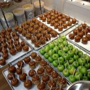 A picture of apples being prepared to make Caramel Apples