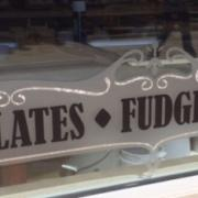 "Photo of ""Chocolates, Fudge & Ice Cream"" decal on store window"