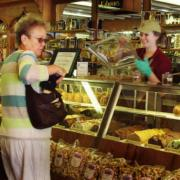 Shopping at the Kilwins Chocolates and Made in Store products case