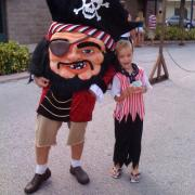 Photo of child eating Ice Cream in pirate costume with pirate mascot