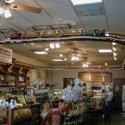 Photo of inside of Kilwins Delray Beach, FL store showing toy train
