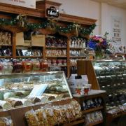 Photo of inside of Kilwins Delray Beach, FL store showing product displays