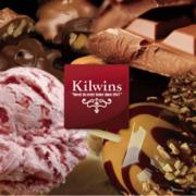 Photo of array of Kilwins Products with Kilwins logo