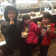 Photo of 3 children enjoying Ice Cream in store