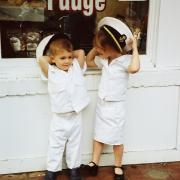 Two children in uniform outside of the store