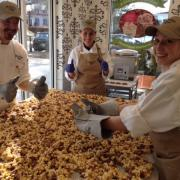 Photo of team members spreading Caramel Corn on marble table