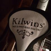 Photo of bicycle seat with Kilwins logo