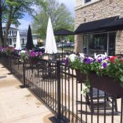 Photo of fence & patio outside Kilwins Geneva