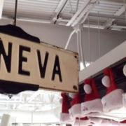 "Photo of sign that says, ""GENEVA"" with Santa Hats"