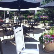 Photo of tables & chairs on patio outside Kilwins Geneva