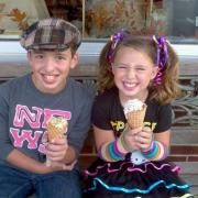 Two children enjoying ice cream at Kilwins