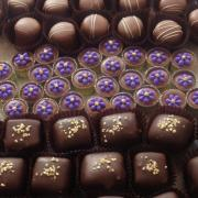 Putting together some custom party favors: Champagne truffles, milk chocolate party cups, and our sea-salt caramels.