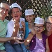 A picture of kids enjoying Kilwins Hot Fudge Ice Cream topping