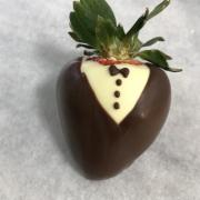 Photo of custom Chocolate-dipped Strawberries decorated like a tuxedo for wedding
