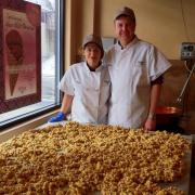A photo of the owners and a table of Caramel Corn